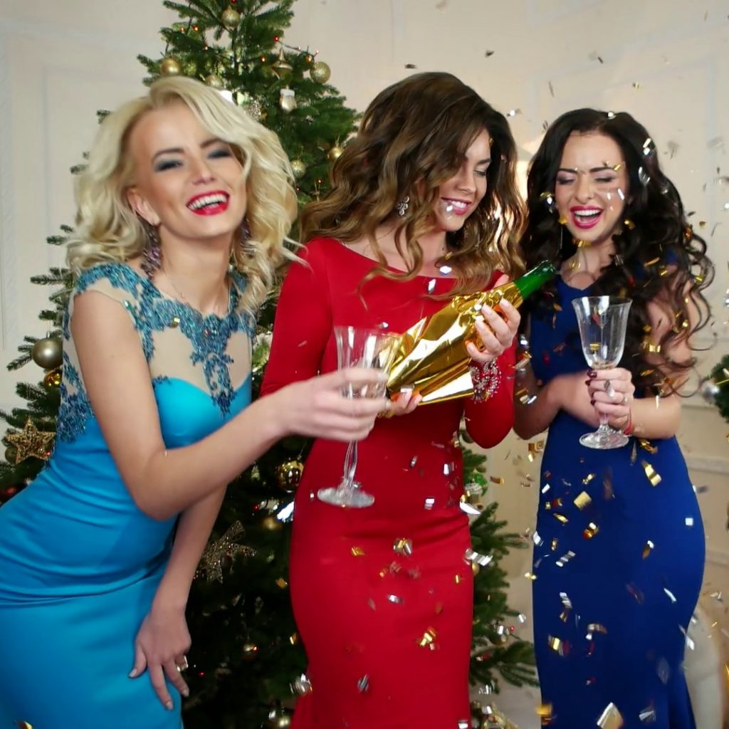 champagne-pouring-into-a-glass-girl-at-a-party-new-years-eve-celebration-beautiful-young-woman-celebrating-christmas-drink-alcohol-girlfriend-happy-are-laughing_b511or6eg_thumbnail-full01