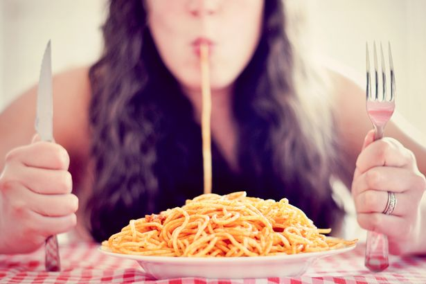 Woman-eating-a-plate-of-spaghetti