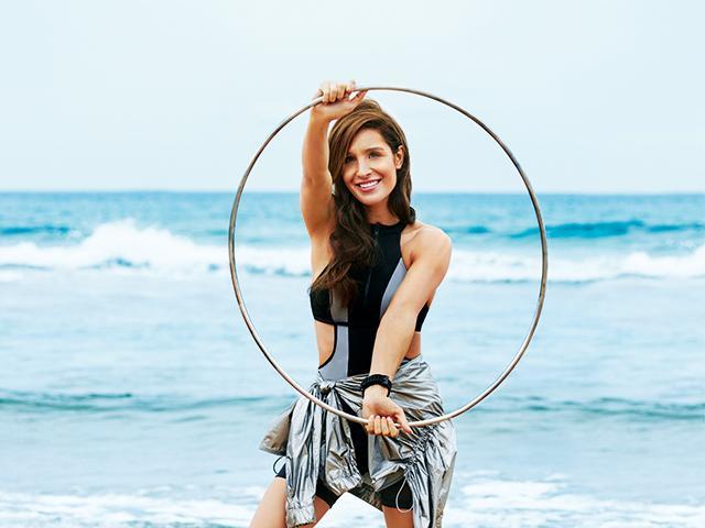 kayla itsines - cover interview -holding hoop - womens health uk  medium 4x3