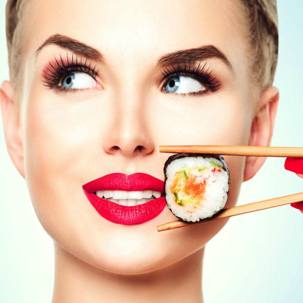 woman-eating-sushi-e1461972427395-1024x694....