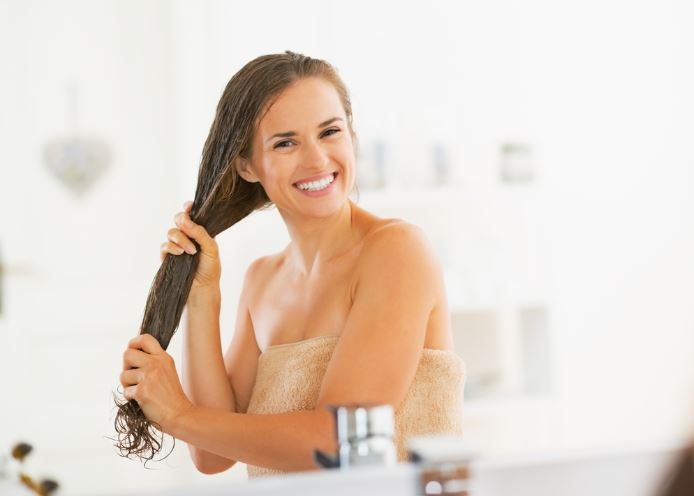 woman-applying-hair-mask