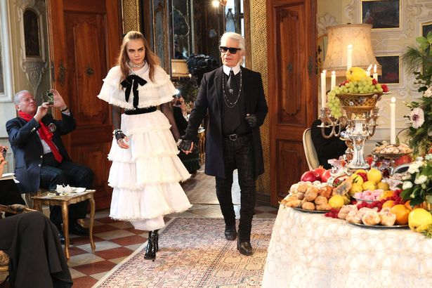 model-cara-delevigne-and-designer-karl-lagerfeld-during-the-chanel-metiers-dart-collection-201415-paris-salzburg-on