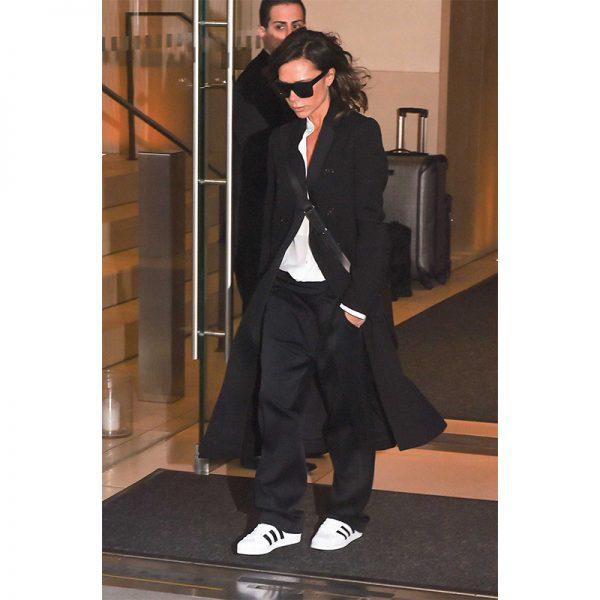 victoria-beckham-black-coat-pants-sneakers-800-600x600