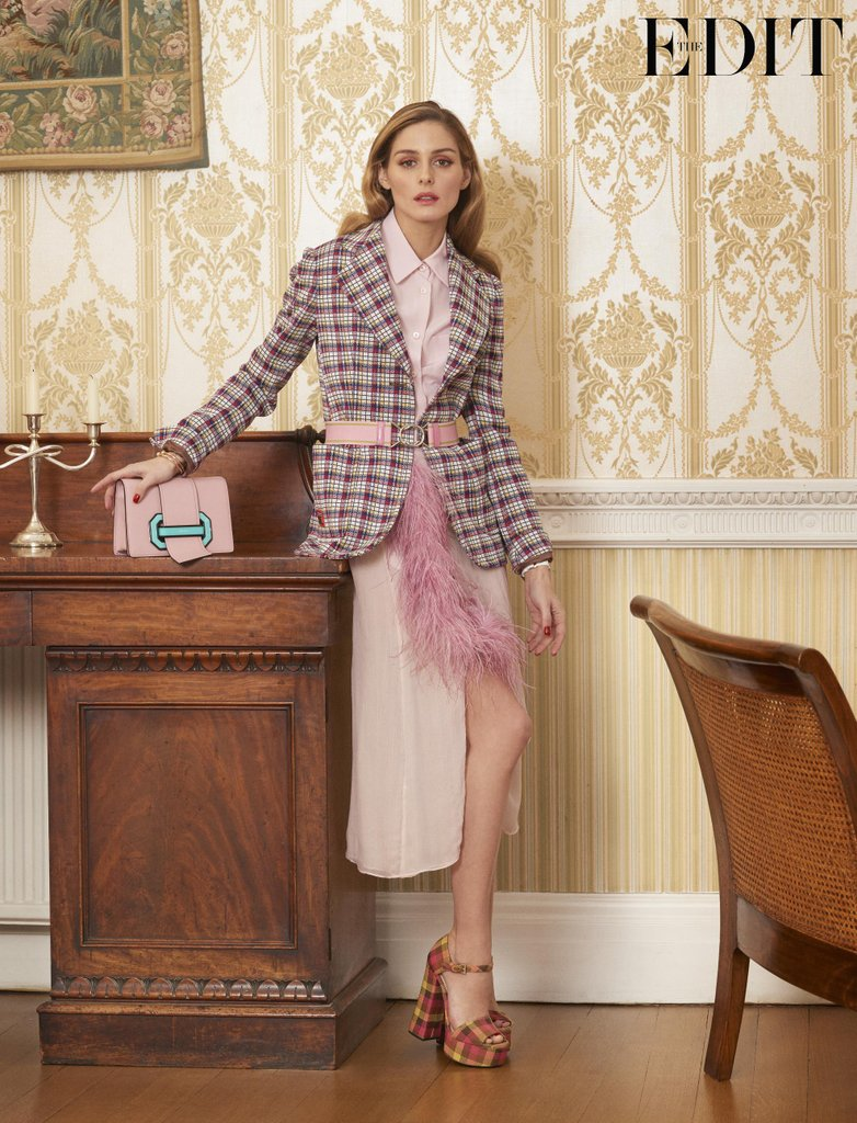 Olivia-wears-blazer-shirt-skirt-sandals-bag-Prada-watch