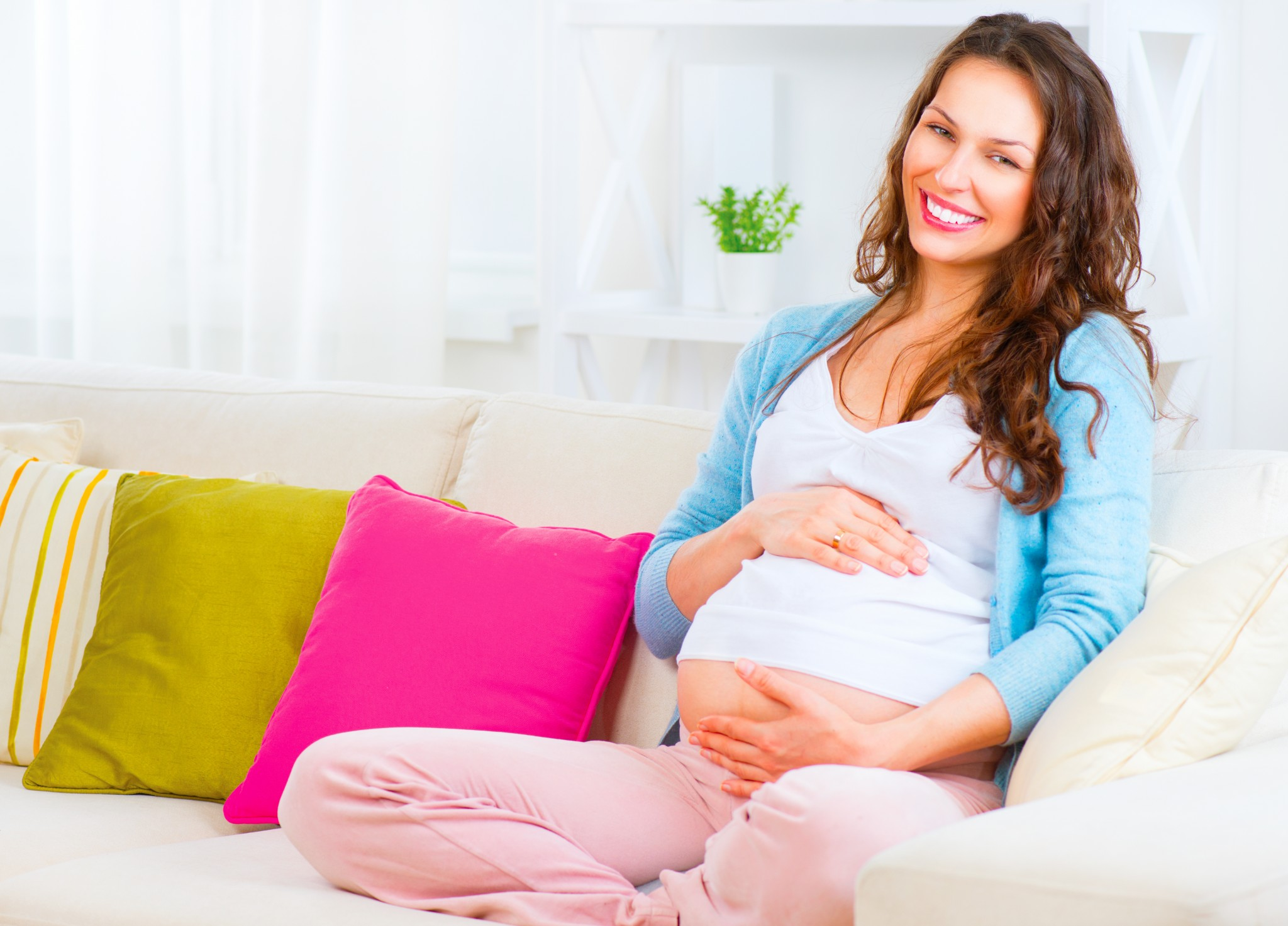 bigstock-Pregnant-Happy-smiling-Woman-s-77746199