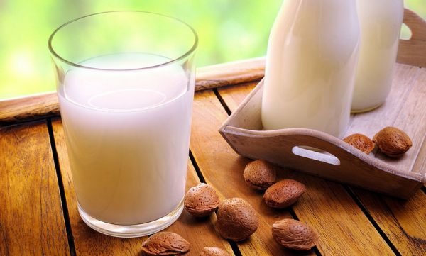 bigstock-Glass-Of-Almond-Milk-On-A-Tabl-83478887