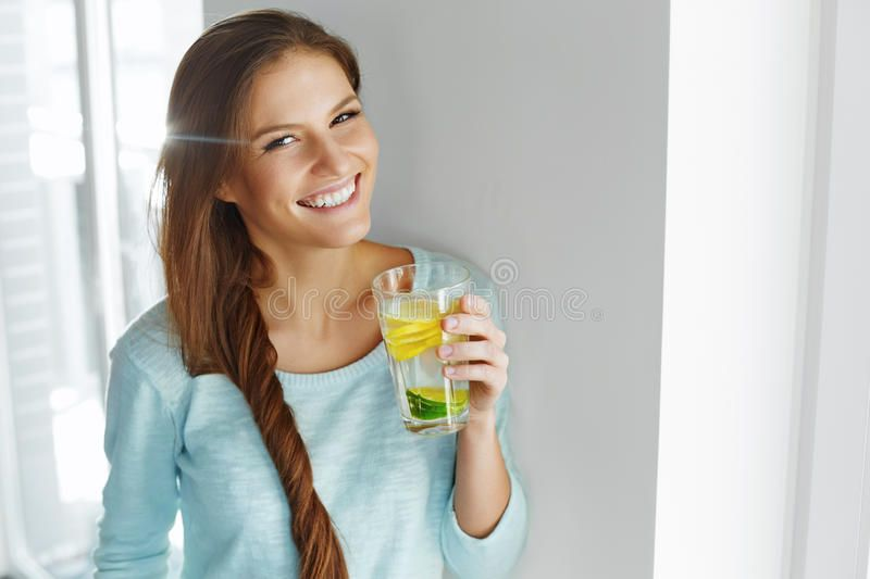 healthy-lifestyle-food-woman-drinking-fruit-water-detox-h-happy-summer-refreshing-flavored-infused-fresh-organic-lemon-62191790