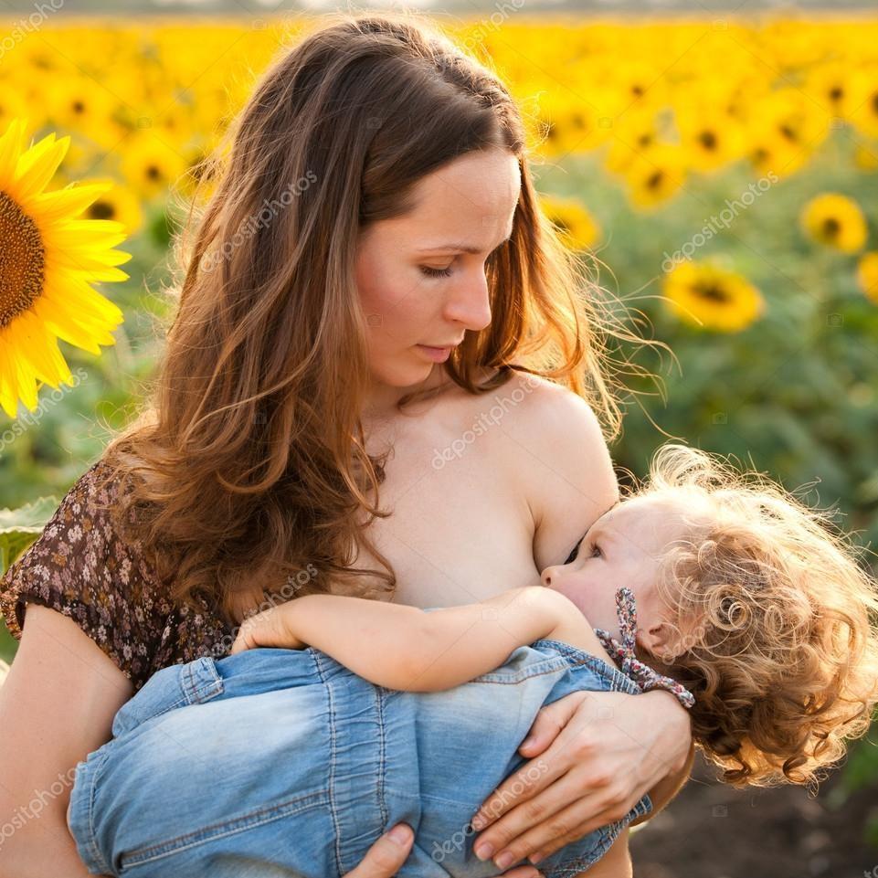 depositphotos_8485495-stock-photo-woman-breastfeeding-baby