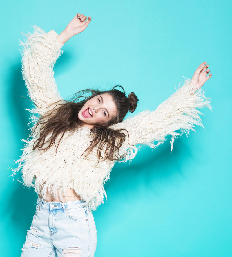 beautiful-happy-smiling-woman-laughing-girl-studio-portrait-cheerful-fashion-hipster-going-crazy-making-funny-face-dancing-53403779