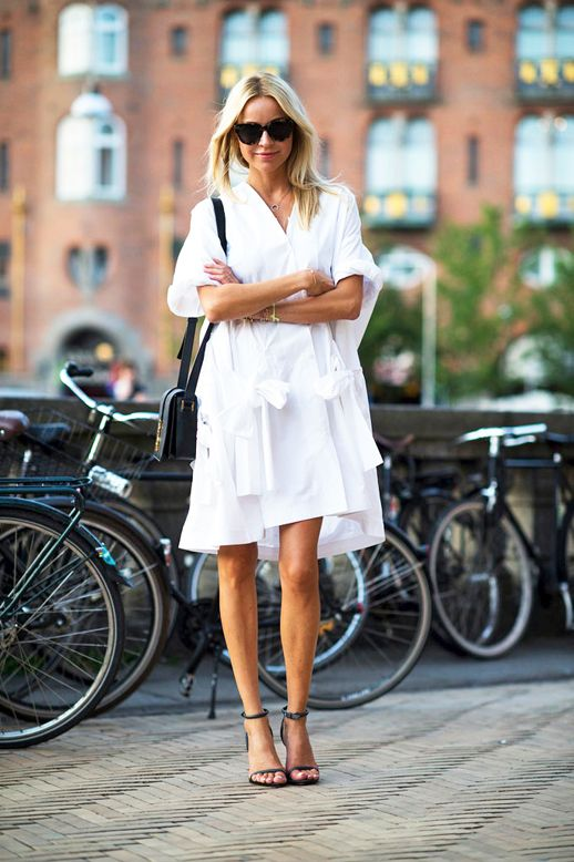 Le-Fashion-Blog-Street-Style-Editor-Hege-Aurelie-Badendyck-White-Tie-Front-Shirtdress-With-Multiple-Ties-Small-Crossbody-Bag-Heeled-Sandals-With-Ankle-Straps-Via-T-Magazine