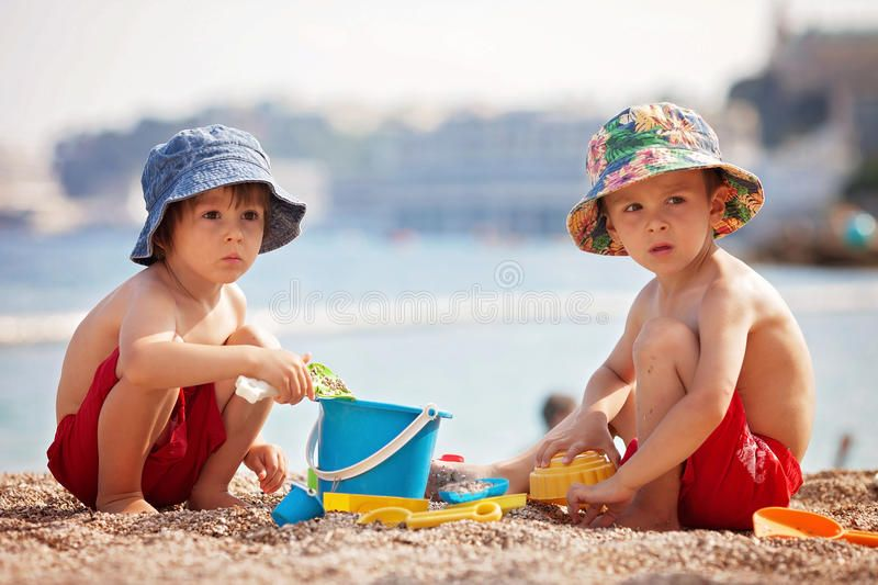 two-cute-kids-playing-sand-beach-summertime-96191462