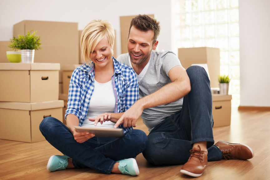 Couple-researching-furniture-in-an-empty-house