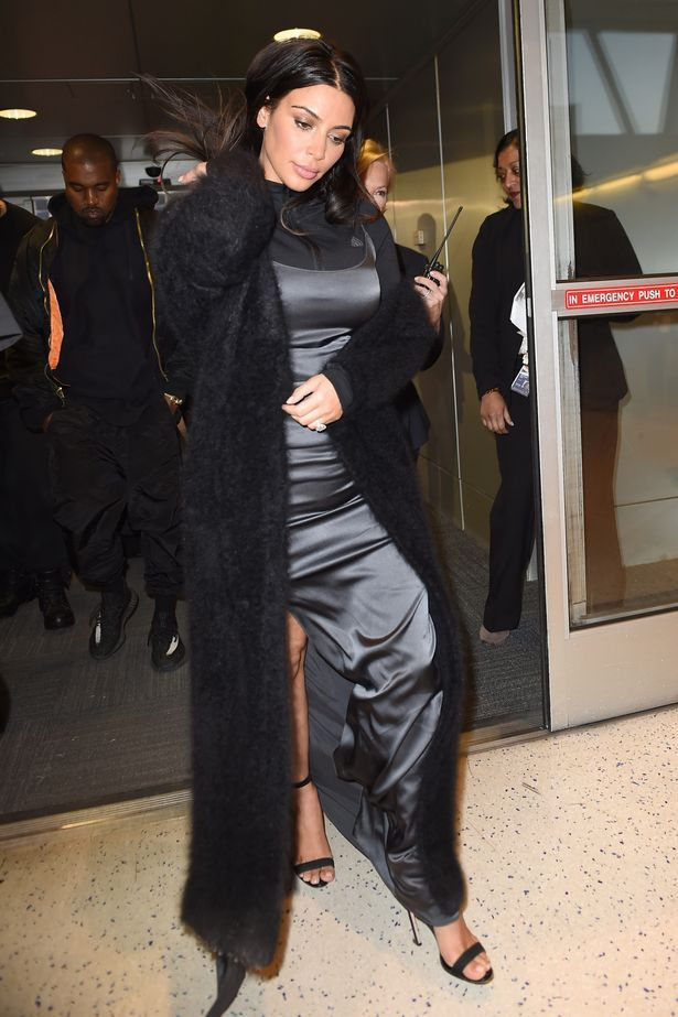 Kim-Kardashian-wearing-a-grey-and-black-gown-and-Kanye-West-seen-leaving-JFK